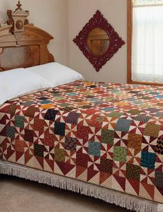Kim Diehl design; great pattern and easy, just plain squares and pinwheels for the main part and HST for the borders.