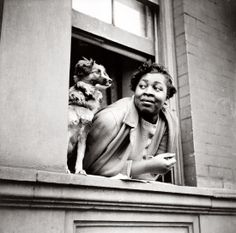A woman and her dog in the Harlem section. May 1943.