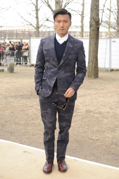 Nicholas Tse wears a Valentino suit, shirt and pull from the Spring Summer 2014 collection and Valentino Camu Look Sunglasses from the Spring Summer 2014 collection to the Valentino Fall Winter 14/15 Fashion Show, March 4th, 2014, Paris. paris, shirts, spring summer, fashion center, nichola tse, suits, winter fashion, fashion looks, random stuff