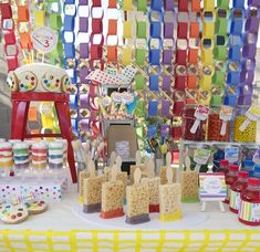 A super easy and inexpensive DIY rainbow backdrop dresses up this sweet table. #rainbow #birthday #party #DIY #dessert #table