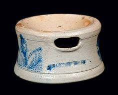 "Price Realized: $ 488.75 Scarce Cobalt-Decorated Stoneware Spittoon, Stamped ""HARRISBURG. PA,"" William Moyer, Harrisburg, PA, circa 1859-1860, with rounded foot and tooling near base, decorated with three brushed cobalt flowering plants around the body. Excellent condition with a small nick and light wear on top edge of spittoon, a small stone ping to shoulder, and a chip to opening at shoulder. H 4 1/2"" ; Diameter 8""."