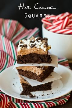 Hot Cocoa Squares {Tastes of Lizzy T}  This starts with a boxed cake mix. Add some homemade hot chocolate buttercream and top with chocolate chips and Kraft marshmallow bits! http://www.tastesoflizzyt.com/2013/12/02/hot-cocoa-squares/