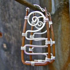 These are really cool. Mixed Metal Rectangular Hoop Earrings Recycled by FullSpiral, $70.00 these are really cool
