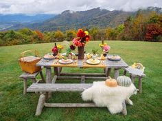 With a few seasonal touches, a rustic picnic table becomes a show-stopping setting for a fall dinner party