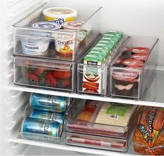 Use clear stackable bins to organize fridge. Crate and Barrel
