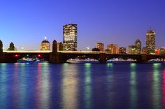 The T - the red line subway - streaks towards Cambridge from Boston over the Longfellow Bridge on the Charles River.