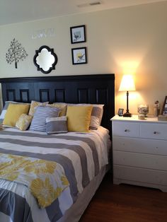 Grey and yellow master bedroom!- I actually like the stripes in this one! :)