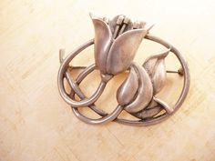 """This Vintage Sterling solid brooch has wired in Stamins that come up out of the flower. The brooch is quite large ( 2 1/4"""" ) and weighs 23.9 grams. It is marked sterling on the back ( see..."""