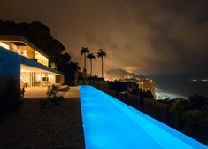 Casa AL by Studio Arthur Casas sits between a mountain and the ocean
