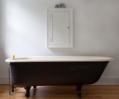 simple cabinet over clawfoot tub