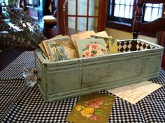 Using an old sewing machine drawer to hold vintage cards--The Cottage Market: 25 Vintage Decorating Tips