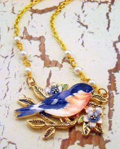 Blue bird of happiness necklace.