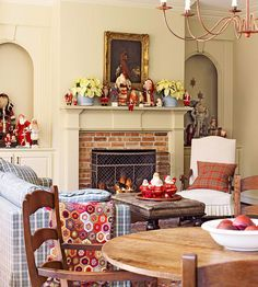 Decorate with Christmas Collectibles - make your holiday collections shine! More beautiful holiday rooms: http://www.bhg.com/christmas/indoor-decorating/pretty-christmas-living-rooms/