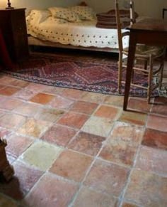 terracotta floor - like the different shades. Makes it softer.