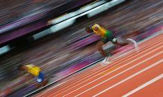 Jamaica's Usain Bolt runs through the turn in his men's 200m semi-final. Photograph: Kai Pfaffenbach/Reuters