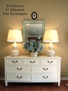 White dresser, painted mirror, chunky lamps