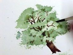 mini tutorial on painting trees by blotting with paper towel to lift areas of the paint.