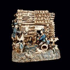 "Stoneware Log Cabin Group (""The Arkansas Traveler""), probably Anna Pottery"