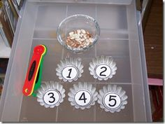 fine motor - sorting with spoons