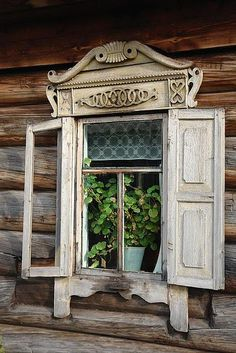 Old Window...with architectural salvage & wooden shutters ... on an old log cabin.