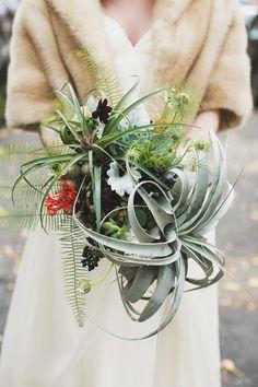 air plant bouquet, photo by Katie Osgood http://ruffledblog.com/green-building-brooklyn-wedding #weddingflowers #weddingbouquet #flowers