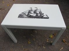 Danish modern table, Damage to veneered top to deep to refinish. Pale blue paint and tall ship graphic transfer.