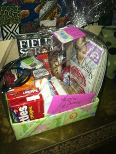 """""""Hospital Survival Kit"""" - For soon to be 1st time mom and dad!  Kit includes:   Magazine for each mom and dad   mixed nut granola bars   a couple of different candies   face wipes   burts bees travel kit   Crest Wisps    Hair bands   Mints   Pad liners (for after)   Gift Card for pizza near the hospital"""