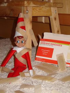 Elf on the Shelf got a boo-boo and band-aids!
