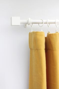 Save your dollars for drapes with this budget curtain rod and finial DIY!