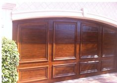 Faux wood finish on garage doors.