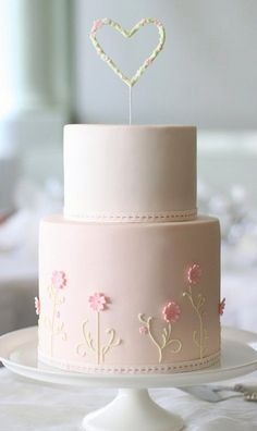 Delicate Pastel Pink Wedding Cake with Dainty Little Flowers