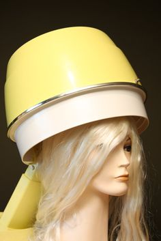 hair dryer.  Had a portable one of these that used a plastic cap then a hose went from the cap to the actually hair dryer.  Got used every Saturday night when my mother washed my hair then rolled it.