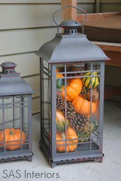 Mini pumpkins and gourds in a lantern for Fall.  GOOD IDEA: cut hole for tea light candle in mini pumpkin in lantern.