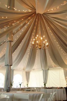 Fabric Swags in Tent with twinkle lights!