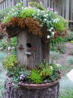Fairy House by Urban Sea Star ~ love the tiny rusted tools affixed by the door, clever idea to place in old saucer and fill with plantings, love the planting on the roof too!