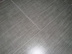 Gray linen floor tile    I love the linen tile look.