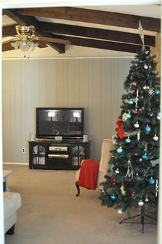 Painting wood paneling How-To with before & after pics. DYING to do this in the near future!!