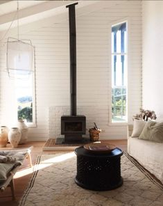 shiplap walls and black wood burning fireplace in whitewashed home via @nataliewalton on instagram. / sfgirlbybay