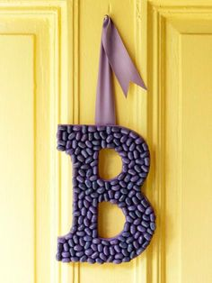 Hot glue jelly beans onto a wood initial | Midwest Living