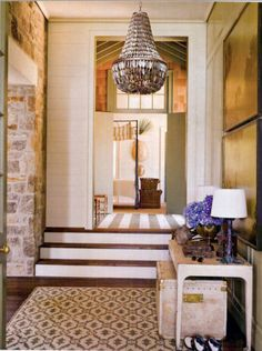 Stone wall, shell basket chandelier; console, trunk; Bill Ingram