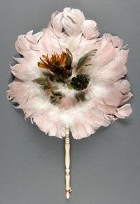 Fan  Made in France  c. 1900  Artist/maker unknown, French  Maribou feathers, humming bird  Diameter: 9 inches (22.9 cm)
