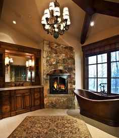 Master bath with copper soaking tub and fireplace | Paula Berg Design
