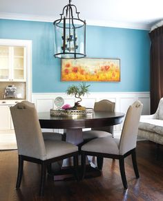 Turquoise dining room, neutral fabric, dark wood, love the spot of yellow and white china cabinet