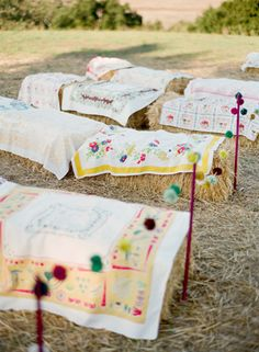 Hay bales covered with quilts - perfect seating for a rustic ceremony. Photo by Ryan Ray Photography. www.wedsociety.com