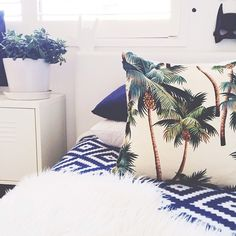 Blue, green, and white. calming bedroom with lots of texture and pattern