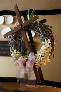 Here's an Easter wreath with a different message.  Loved this bloggers use of reclaimed wood in her design.  DIY wreath.  Spring wreath. Easter decorations. Cross wreath. Resurrection