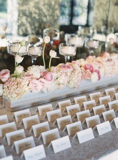 escort card display table w/ pink floral garland box and fluted candle holders