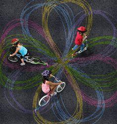 Turn Your Bike Into a Spirograph using sidewalk chalk!