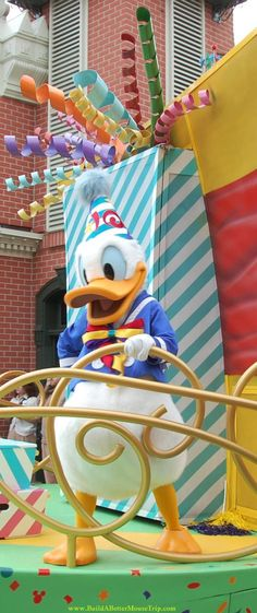 """Donald Duck in the """"Move It! Shake It! Celebrate It! Street Party"""" in the Magic Kingdom at Disney World.   Check your Magic Kingdom Times Guide for exact times during your visit.    For more info, see: https://disneyworld.disney.go.com/entertainment/magic-kingdom/move-it-shake-it-celebrate-it"""