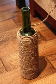 Yarn wrapped bottles (Can be filled with sand and topped with a cork for decorative bookends!)